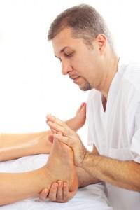 Orthopaed man massaging foot